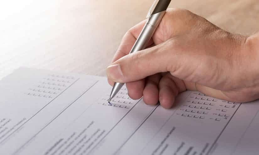 man filling in survey